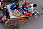 Children on school transport in the Paharganj district of New Delhi, India.
