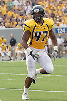 WVU line backer Doug Rigg. The WVU Mountaineers beat the Marshall Thundering Herd 34-13 in a game called just after the fourth quarter started because of severe thunderstorms in the area. The game was played at Milan Puskar Stadium in Morgantown, West Virginia on September 4, 2011.