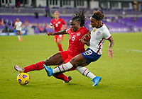ORLANDO CITY, FL - FEBRUARY 18: Crystal Dunn #19 of the United States crosses a ball during a game between Canada and USWNT at Exploria Stadium on February 18, 2021 in Orlando City, Florida.