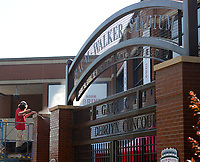 Adam Erwin, an employee with the University of Arkansas Athletics Facilities, uses a pressure washer Thursday, June 3, 2021, to clean one of the gates into Baum-Walker Stadium in Fayetteville as he and other staff members prepare for the NCAA Fayetteville Baseball Regional, which begins today. The University of Arkansas faces New Jersey Institute of Technology and Nebraska faces Northeastern with the team that wins the Regional going on to a Super Regional and a chance to take part in the College World Series. Visit nwaonline.com/210604Daily/ for today's photo gallery.<br /> (NWA Democrat-Gazette/Andy Shupe)