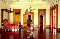 Royal furniture and artifacts in a room of Iolani palace, a four-story Italian Renaissance palace built in 1882 and a home of Hawaiian royalty, Honolulu