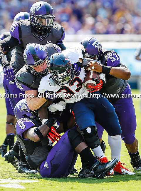 TCU Horned Frogs safety Elisha Olabode (6), TCU Horned Frogs linebacker Joel Hasley (36) and Virginia Cavaliers running back Perry Jones (33) in action during the game between the Virginia Cavaliers and the TCU Horned Frogs  at the Amon G. Carter Stadium in Fort Worth, Texas. TCU defeats Virginia 27 to 7...