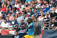 FOXBOROUGH, MA - AUGUST 8: DeJuan Jones #24 of New England Revolution and Olivier Mbaizo #15 of Philadelphia Union battle for head ball during a game between Philadelphia Union and New England Revolution at Gillette Stadium on August 8, 2021 in Foxborough, Massachusetts.