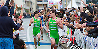 17 SEP 2011 - LA BAULE, FRA - Alistair Brownlee  races down the finish straight to cross the line first just ahead of team mate and brother Jonathan Brownlee during the final round of the French Grand Prix Series triathlon in La Baule, France. The Brownlee's EC Sartrouville team retained the title after winning every round of the 5 race series.(PHOTO (C) NIGEL FARROW)