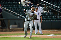 Greensboro Grasshoppers third baseman Jared Triolo (19) makes a throw to first base against the Winston-Salem Dash at Truist Stadium on June 15, 2021 in Winston-Salem, North Carolina. (Brian Westerholt/Four Seam Images)