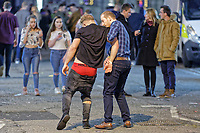 Pictured: A man is helped away by his friend in Wind Street, Swansea. Monday 31 December 2018 and Tuesday 01 January 2019<br /> Re: New Year revellers in Wind Street, Swansea, Wales, UK