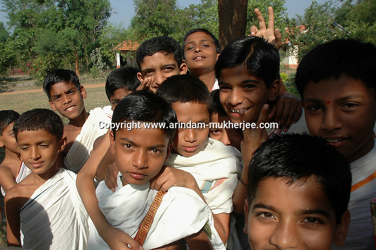 Students at Om Shantidhama. Om Shantidhama is a residential vedic school for boys. Nestled among the confluence of hills, forest and rivers - Om Shanti Dhama is a world removed from the maddeningly fast and often chaotic urban India. Students from allover the country are selected to take part in its Vedic and free education system. What is unique about this institute is that they have blended the traditional and modern education system. Here computer and science is taught with the same passion as the Vedas and Shastras, helping the students to grow spiritually as well as earn a living. Bonding with the nature and animal world is a mandatory part of the institute's curriculum. Karnataka, India. Arindam Mukherjee