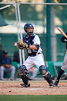 GCL Braves catcher Logan Brown (28) checks a runner during the first game of a doubleheader against the GCL Yankees West on July 30, 2018 at Champion Stadium in Kissimmee, Florida.  GCL Yankees West defeated GCL Braves 7-5.  (Mike Janes/Four Seam Images)
