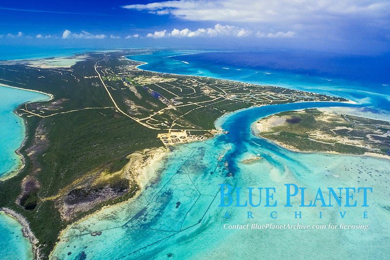 """aerial view looking up """"Leeward Going Through"""" pass at the eastern end of Providencials, Turks and Caicos, conch farms in foreground"""