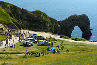BNPS.co.uk (01202 558833)<br /> Pic: Graham Hunt/BNPS<br /> <br /> The coastguard helicopter lands on the beach at Durdle Door in Dorset to deal with a medical emergency on an afternoon of scorching hot sunshine and clear blue skies.<br /> <br /> Coastguard vehicles on the cliff top which are keeping the crowds back for the helicopter to land on the beach.