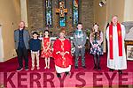 Pupils from Scoil Naomh Gobnait, Dún Chaoin, Cillian Mac Gearailt, Úna Nic Carthaigh, Cathal Feirtéar and Niamh Nic Dhomhnaill the day of their Confirmation, here pictured with their muinteoir Malachaí Mac Amhlaoibh, An tAthair Séamus Mac Ginnea and an tAthair Eoghan Ó Cadhla at Séipéal Naomh Uinseann, Baile an Fheirtéaraigh, on Friday.