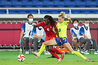 YOKOHAMA, JAPAN - AUGUST 6: Deanne Rose #6 of Canada and Nathalie Bjorn #14 of Sweden battle for the ball during a game between Canada and Sweden at International Stadium Yokohama on August 6, 2021 in Yokohama, Japan.
