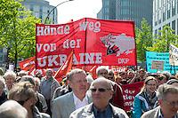 """Ostermarsch 2014 in Berlin.<br />Am Samstag den 19. April 2014 fand in Berlin der traditionelle """"Berliner Ostermarsch"""" fuer Frieden und gegen Ruestung statt. Mehr als 1.000 Menschen kamen zu der Friedensdemonstration, die vom Regierungsviertel zur """"Neuen Wache"""" zog. Auf etlichen Plakaten und Transparenten wurde ein Ende des Buergerkrieges in Syrien, sowie ein Stopp der westlichen Intervention in der Ukraine gefordert. Ebenfalls wurde sich gegen die Entwicklung und Anschaffung von Aufklaerungs- und Kampf-Drohnen fuer die Bundeswehr sowie ein Ende der Bundeswehr-Werbung an Schulen und in Arbeitsaemtern ausgesprochen.<br />19.4.2014, Berlin<br />Copyright: Christian-Ditsch.de<br />[Inhaltsveraendernde Manipulation des Fotos nur nach ausdruecklicher Genehmigung des Fotografen. Vereinbarungen ueber Abtretung von Persoenlichkeitsrechten/Model Release der abgebildeten Person/Personen liegen nicht vor. NO MODEL RELEASE! Don't publish without copyright Christian-Ditsch.de, Veroeffentlichung nur mit Fotografennennung, sowie gegen Honorar, MwSt. und Beleg. Konto: I N G - D i B a, IBAN DE58500105175400192269, BIC INGDDEFFXXX, Kontakt: post@christian-ditsch.de]"""