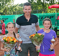 August 9, 2014, Netherlands, Rotterdam, TV Victoria, Tennis, National Junior Championships, NJK,  Prize giving, Richard Krajicek with Carmen van Poelgeest (R) and (L) and Danielle Rieff  winners  girls doubles 12 years<br /> Photo: Tennisimages/Henk Koster