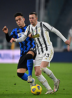Football Soccer: Tim Cup Semi Finals second leg Juventus vs InternazionaleMilan, Allianz Staium Stadium in Turin, on February 9, 2021.<br /> Juventuss' Federico Bernardeschi (r) in action with Inter's Lautaro Martinez (l) during the Italian Tim Cup Semi Final match between Juventus vs InterMilan at Allianz Stadium in Turin, on February 9, 2021.<br /> UPDATE IMAGES PRESS/Isabella Bonotto