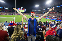 NASHVILLE, TN - SEPTEMBER 5: A USA Fans urges other fans to cheer during a game between Canada and USMNT at Nissan Stadium on September 5, 2021 in Nashville, Tennessee.