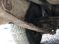 BNPS.co.uk (01202) 558833. <br /> Pic: Charterhouse/BNPS<br /> <br /> Pictured: Leaf spring suspension at the rear. <br /> <br /> A clapped-out Ford Escort which has been languishing in a garage for nearly 25 years is tipped to sell for £25,000.<br /> <br /> The rare 1975 Mk 1 RS2000 model is in a rusty state and is in need of lots of care and attention.