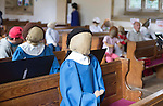 Scarecrow Festival at Kettlewell in Yorkshire 2013<br /> <br /> Nuns in the congregation<br /> <br /> <br /> Scarecrows are made by local community and places in and around their front gardens.  Competition is fierce but it's all to raise money  for the local church  and other local projects to benefit the whole community.<br /> <br /> <br /> <br /> Picture by Gavin Rodgers/ Pixel 8000 <br /> <br /> 07917221968