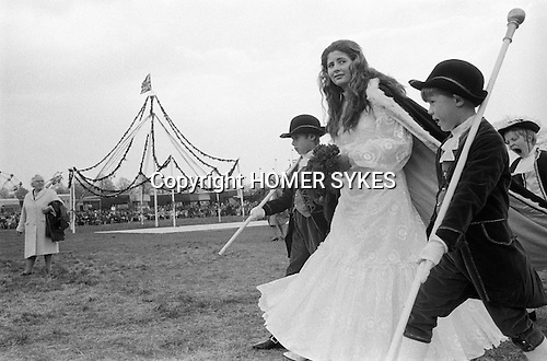 Royal May Day Knutsford, Cheshire, England 1973. Miss Eliane Murray, the 1973 May Queen with attendants making her way to the crowning ceremony.<br /> <br /> The first May Queen was Annie Sarah Pollitt  in 1864