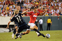 Toni Stahl (12) of the Philadelphia Union  attempts a tackle on Dimitar Berbatov (9) of Manchester United. Manchester United (EPL) defeated the Philadelphia Union (MLS) 1-0 during an international friendly at Lincoln Financial Field in Philadelphia, PA, on July 21, 2010.