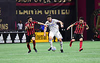 ATLANTA, GA - MARCH 07: ATLANTA, GA - MARCH 07: FC Cincinnati defender Mathieu Deplagne dribbles the ball by Jake Mulraney during the match against Atlanta United, which Atlanta won, 2-1, in front of a crowd of 69,301 at Mercedes-Benz Stadium during a game between FC Cincinnati and Atlanta United FC at Mercedes-Benz Stadium on March 07, 2020 in Atlanta, Georgia.