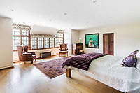 BNPS.co.uk (01202 558833)<br /> Pic: Hamptons/BNPS<br /> <br /> Pictured: A bedroom.<br /> <br /> An incredible Arts and Crafts country house with its own vineyard is on the market for offers over £7m.<br /> <br /> The Grade II listed St Joseph's Hall is a striking 111-year-old property that was home to the Bishop of Arundel for 40 years.<br /> <br /> It has a wealth of period features, an indoor swimming pool and seven acres of vineyard with mostly Chardonnay grapes, which the owners sell to a local winery.<br /> <br /> The house in Storrington, West Sussex, has 17 acres of land with beautiful views over the South Downs.