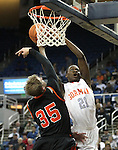 Gorman's Demetris Morant shoots over Douglas defender Hunter Myers during a semi-final game in the NIAA 4A State Basketball Championships between Bishop Gorman and Douglas high schools at Lawlor Events Center in Reno, Nev, on Thursday, Feb. 23, 2012. .Photo by Cathleen Allison