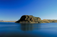 Elephant Butte juts out of Elephant Butte Lake, a huge reservoir. rock formations, waterway, geology. New Mexico, Elephant Butte Dam.
