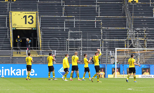 16th May 2020, Signal Iduna Park, Dortmund, Germany; Bundesliga football, Borussia Dortmund versus FC Schalke; The Dortmund team celebrate as if the fans were in the stands for them