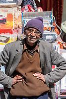 India, Dehradun.  Indian Gentleman on a Busy Market Street.