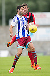 St Johnstone v Real Sociadad...12.07.15  Bayview, Methil (Home of East Fife FC)<br /> Imanol Agirretxe is tackled by Tam Scobbie<br /> Picture by Graeme Hart.<br /> Copyright Perthshire Picture Agency<br /> Tel: 01738 623350  Mobile: 07990 594431