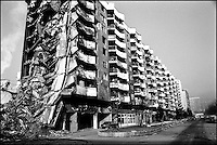 An apartment building near downtown Sarajevo. The war in the early 1990's destroyed most of the city. Sarajevo, Bosnia-Herzegovina, January 1999 © Stephen Blake Farrington<br />