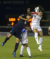 Mariana Barrantes of Costa Rica (right) goes up for the header against  Ali Krieger (left). USWNT vs Costa Rica in the 2010 CONCACAF Women's World Cup Qualifying tournament held at Estadio Quintana Roo in Cancun, Mexico on November 8th, 2010.