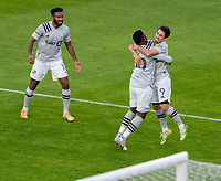 WASHINGTON, DC - NOVEMBER 8: Romell Quioto #30 and Bojan #9 of the Montreal Impact celebrate a goal during a game between Montreal Impact and D.C. United at Audi Field on November 8, 2020 in Washington, DC.