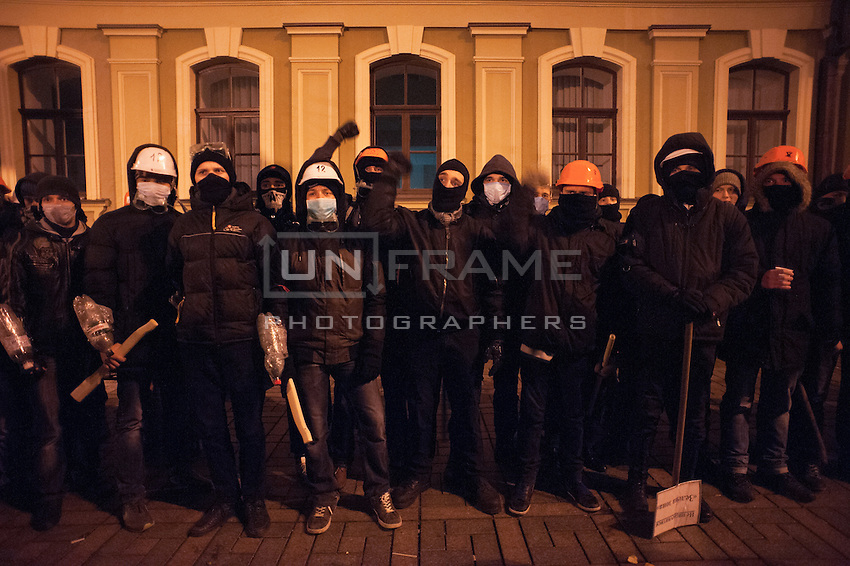 Group of young nationalists cheering their leader during the night shift-guard against expected attack of special forces. After the violent event when crowd on Independence Square in Kiev was dispersed and more than 30 students were badly hurt, many people expressed their wish to be guards of barricades during nights.