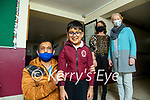 BACK TO SCHOOL: Alam Khan with his son Ethan who was delighted to be back in the classroom in Moyderwell primary school on Tuesday also in pic are Catherine Walsh SNA and Moira Quinlan Principal
