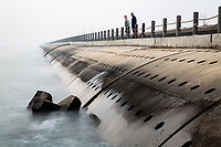 A sea wall which protects part of Tianjin port. The port has been built largely on reclaimed land and is now one of the busiest port cities in the world. It is protected predominantly by sea walls of various shapes and sizes which help shelter the coastline and the ships delivering goods in and out of northern China. 2019