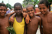 Bahia, Brazil. Group of mixed-race boys about 12 years old, smiling.