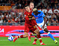 Calcio, Serie A: AS Roma vs SSC Napoli, Olympic stadium, October 24, 2021.<br /> Napoli's Victor Osimhen (R) in action with Roma's Gianluca Mancini (L) and Rick Karsdorp (C) during the Italian Serie A football match between Roma and Napoli at Rome's Olympic stadium, on , October 24, 2021. <br /> UPDATE IMAGES PRESS/Isabella Bonotto
