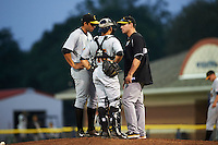 West Virginia Black Bears mound meeting with pitcher Juan Paula (46), catcher Christian Kelley (16) and pitching coach Matt Ford during a game against the Batavia Muckdogs on August 31, 2015 at Dwyer Stadium in Batavia, New York.  Batavia defeated West Virginia 5-4.  (Mike Janes/Four Seam Images)