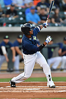 Second baseman Luis Carpio (18) of the Columbia Fireflies hits in a game against the Lexington Legends on Friday, April 21, 2017, at Spirit Communications Park in Columbia, South Carolina. Columbia won, 5-0. (Tom Priddy/Four Seam Images)
