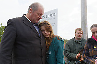 "Pictured L-R: Byron John is embraced by his daughter Danielle and partner Kate Pickard  after delivering the letter to St John Lloyd School in Llanelli, Wales, UK. Friday 21 September 2018<br /> Re: The grieving father of a bullied pupil who hanged himself in school toilets is calling for the headteacher's resignation.<br /> Heartbroken Byron John claims his son Bradley, 14, would still be alive if the school had acted to stop the bullies.<br /> Mr John, 53, will hand in a formal letter of complaint to the school today (Fri) demanding head Ashley Thomas resigns.<br /> Bradley's 12-year-old sister Danielle found him dead in the toilet block at St John Lloyd Roman Catholic School in Llanelli, South Wales.<br /> Mr John claims his son had been missing for an hour before teachers refused to break down the door of the cubicle where the troubled teenager was found.<br /> Farmer Mr John said: ""I'm very unhappy at the way the school has handled things both before Bradley died, on the day it happened and since.<br /> ""There was a systematic failure of any workable anti-bullying policy.<br /> ""There was a failure to follow up our concerns and those of the healthcare professionals helping my son."""