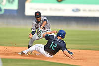 Bowling Green Hot Rods shortstop Greg Jones (2) attempts to apply the tag as Matt Barefoot (12) slides into second base during a game against the Asheville Tourists on May 29, 2021 at McCormick Field in Asheville, NC. (Tony Farlow/Four Seam Images)