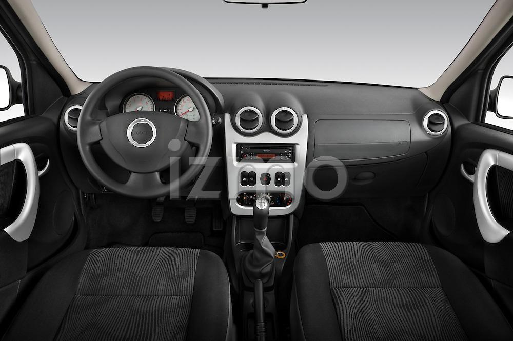 Straight dashboard view of a 2009 Dacia Logan Laureate Minivan.