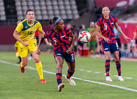 KASHIMA, JAPAN - AUGUST 5: Crystal Dunn #2 of the USWNT looks to the ball during a game between Australia and USWNT at Kashima Soccer Stadium on August 5, 2021 in Kashima, Japan.
