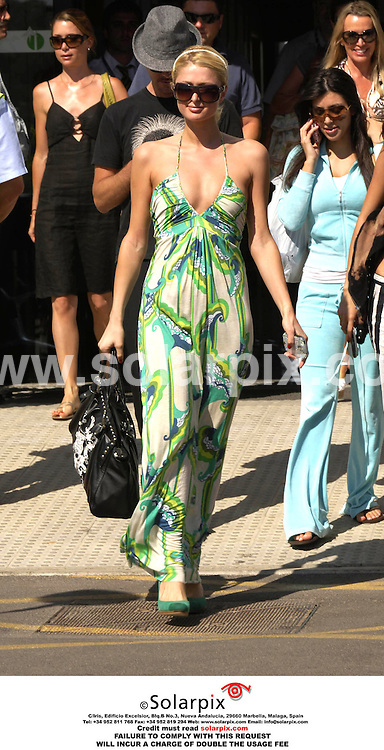 ALL ROUND PICTURES FROM SOLARPIX.COM.*MUST CREDIT SOLARPIX.COM OR DOUBLE FEE WILL BE CHARGED*.Paris Hilton arriving at Palma de Mallorca airport on Friday she is in Palma to promote a new drink and her new 'song stars are blind'..DATE:21-07-06-JOB REF:2614-SPA