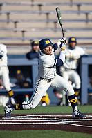 Michigan Wolverines outfielder Tito Flores (22) follows through on his swing during the NCAA baseball game against the Illinois Fighting Illini at Fisher Stadium on March 19, 2021 in Ann Arbor, Michigan. Illinois won the game 7-4. (Andrew Woolley/Four Seam Images)
