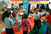 MR/ Schenectady, New York.Yates Arts Magnet School / Pre-Kindergarten .Students (aged 4-5) move to music. .MR: YS-7-PK      FC#:20320-00507.scan from slide.© Ellen B. Senisi