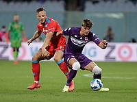 3rd October 2021; Franchi Stadium, Florence, Italy; Serie A football, Fiorentina versus Napoli : Amir Rrhamani of Napoli challenges Dusan Vlahovic of Fiorentina
