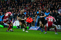 Friday 03 January 2014<br /> Pictured: Tom Issacs ( with ball) tries to break through the scarlets backs <br /> Re: Ospreys v Scarlets, Rabo Direct Pro 12 match at the Liberty Stadium Swansea, Wales